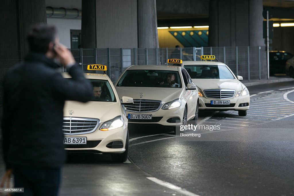 Taxi drivers sit in mercedes benz automobiles for Mercedes benz credit corp