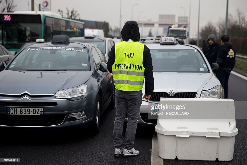 french taxis drivers demonstrate against uber in paris getty images. Black Bedroom Furniture Sets. Home Design Ideas