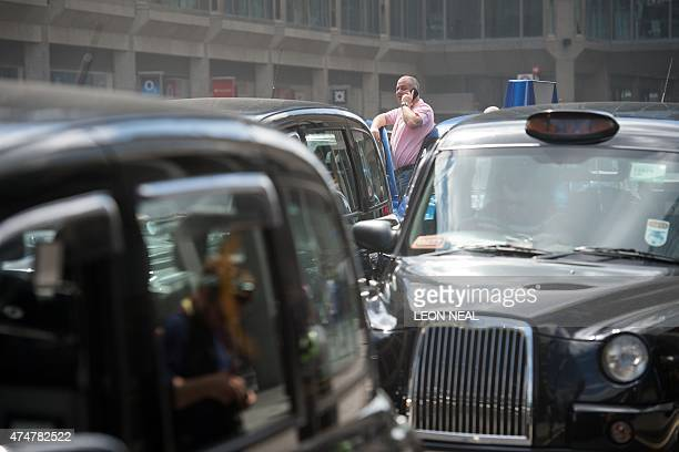 Taxi drivers take part in a demonstration in central London on May 26 against mobile app Uber and regulator Transport for London to highlight a...
