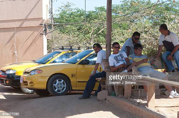 Taxi drivers wait for customers in Playa Tamarindo in Costa Rica