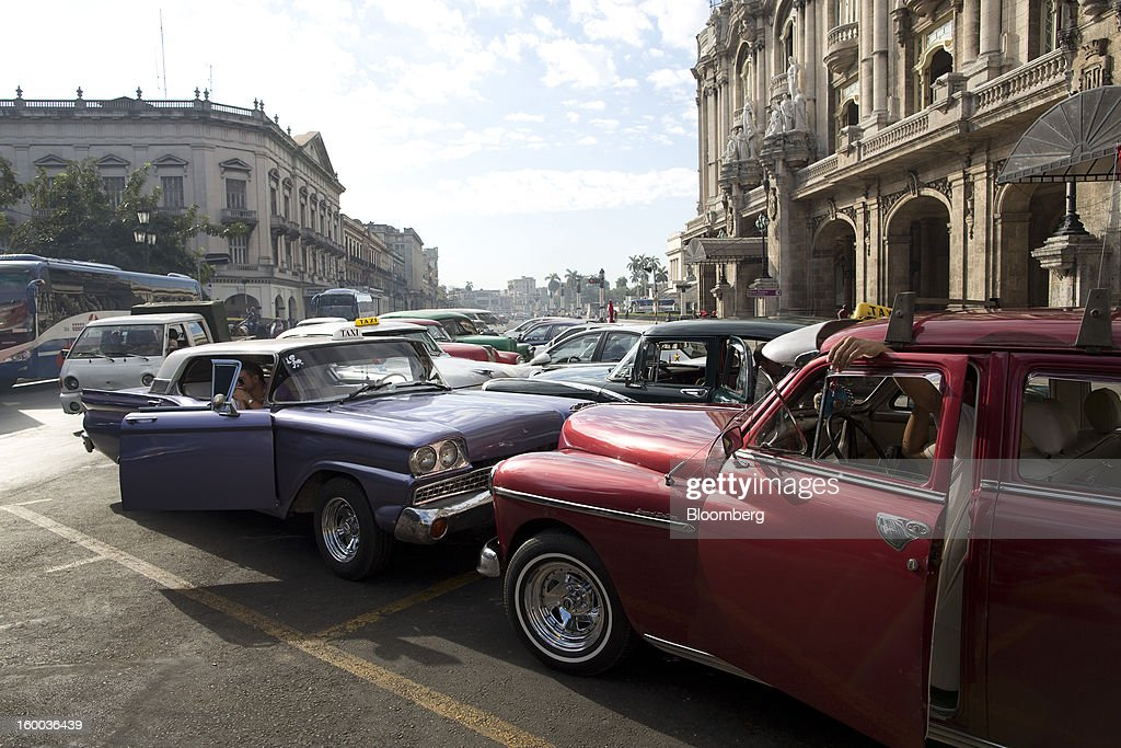 Taxi drivers wait for customers in their American-made automobiles in central Havana, Cuba, on Thursday, Jan. 17, 2013. In a country where the average monthly salary is $19, according to Cuba's statistics agency, even buying an airplane ticket will be beyond the reach of most of the island's 11 million residents as President Raul Castro begins easing travel rules on the communist island. Photographer: Andrey Rudakov/Bloomberg via Getty Images