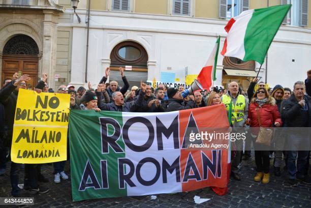 Taxi drivers who are on strike to protest the amendment on appbased car transport company Uber shout slogans a demonstration in Rome Italy on...