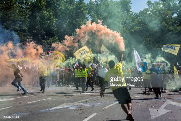 Taxi drivers with smoke bombs protesting during a demonstration against private services such as Uber and Cabify demanding Government to apply...