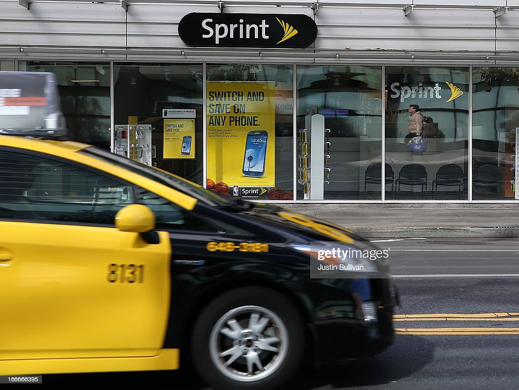 A taxi drives by a Sprint store on April 15, 2013 in San Francisco, California. Dish Network Corp has offered to purchase Sprint Nextel Corp for $25.5 billion in cash and stock.