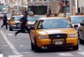 A taxi drives down the street February 22 2002 in New York City Claiming that the taxi industry can not attract enough drivers New York City Mayor...