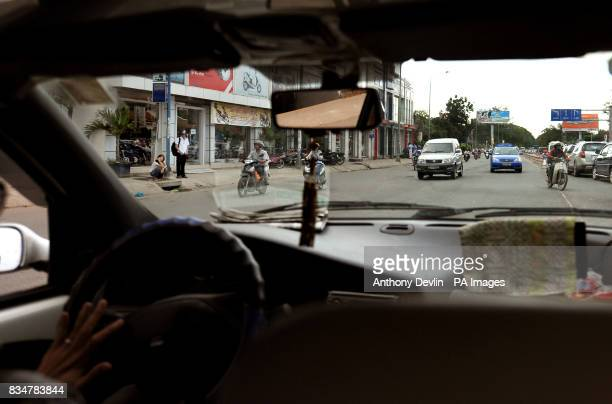 A taxi drives on the wrong side of a duel carriage way in Ho Chi Minh City Vietnam