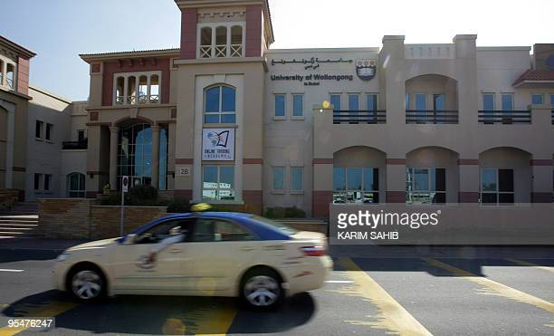A taxi drives past a branch for the University of Wollongong where Nigerian Umar Farouk Abdulmutallab spent few month studying in Dubai on December...
