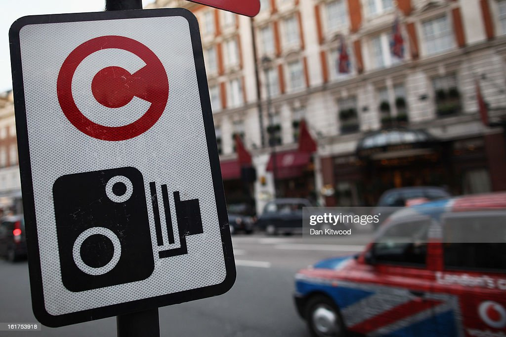 A taxi drives past a congestion charge sign near Victoria on February 15, 2013 in London, England. The weekday charge was introduced by the then Mayor of London Ken Livingstone on February 17, 2003 and celebrates its tenth anniversary on Sunday. Originally costing 5 GBP it has risen over the years to its current price of 10 GBP.