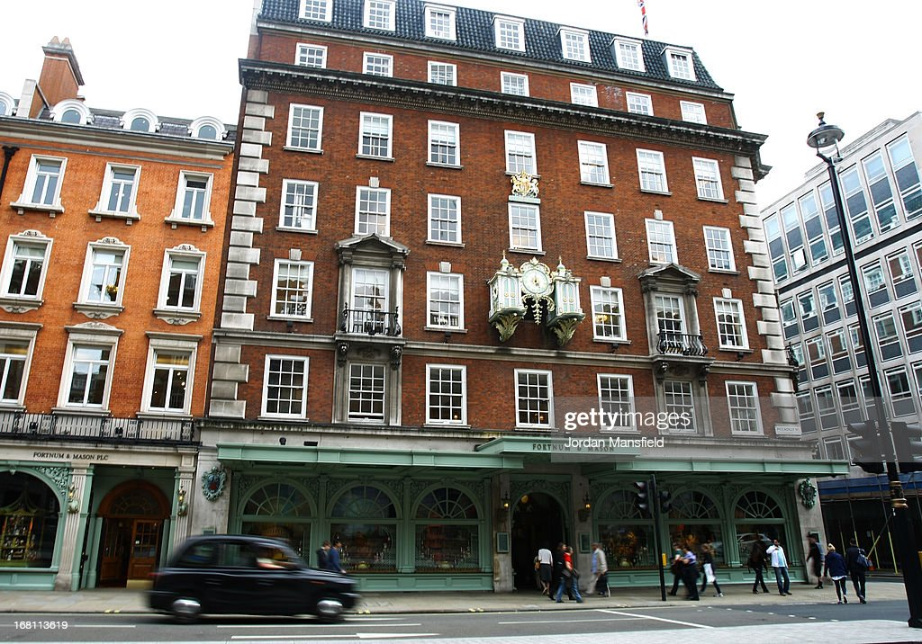 A taxi drives past Fortnum and Mason on May 5, 2013 in London, England. Fortnum and Mason have kept bees on their rooftop terrace for the last 7 years. At this time of year, the London Honey Company return the bees to their renovated hives.