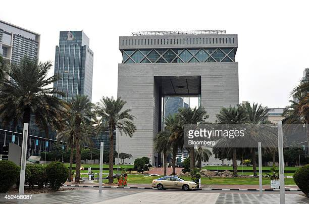 A taxi drives past the Dubai International Financial Centre in Dubai United Arab Emirates on Thursday Nov 21 2013 Speculation that Dubai will be...