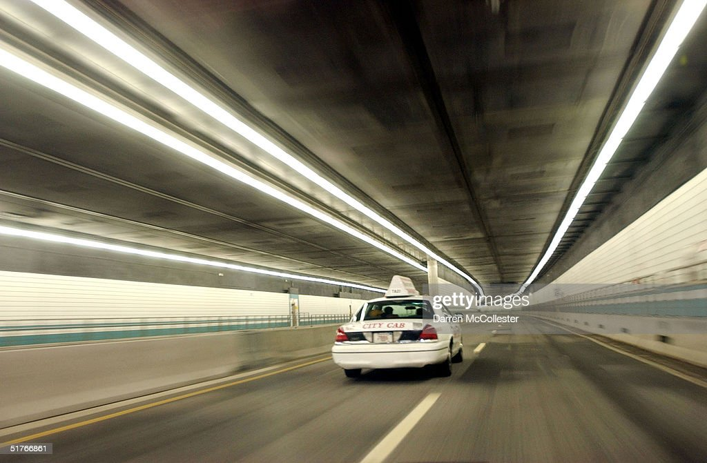 A taxi drives through the 'Big Dig' Interstate 93 North tunnel November 19, 2004 in Boston, Massachusetts. More than 400 leaks have been discovered recently, due to faulty watereproof panels along the Interstate 93 section of the nation's costliest federally funded transportation project. Already at 14.6 billion dollars, Big Dig officials expect the leaks to cost upwards of 10 million more, and years to fix.