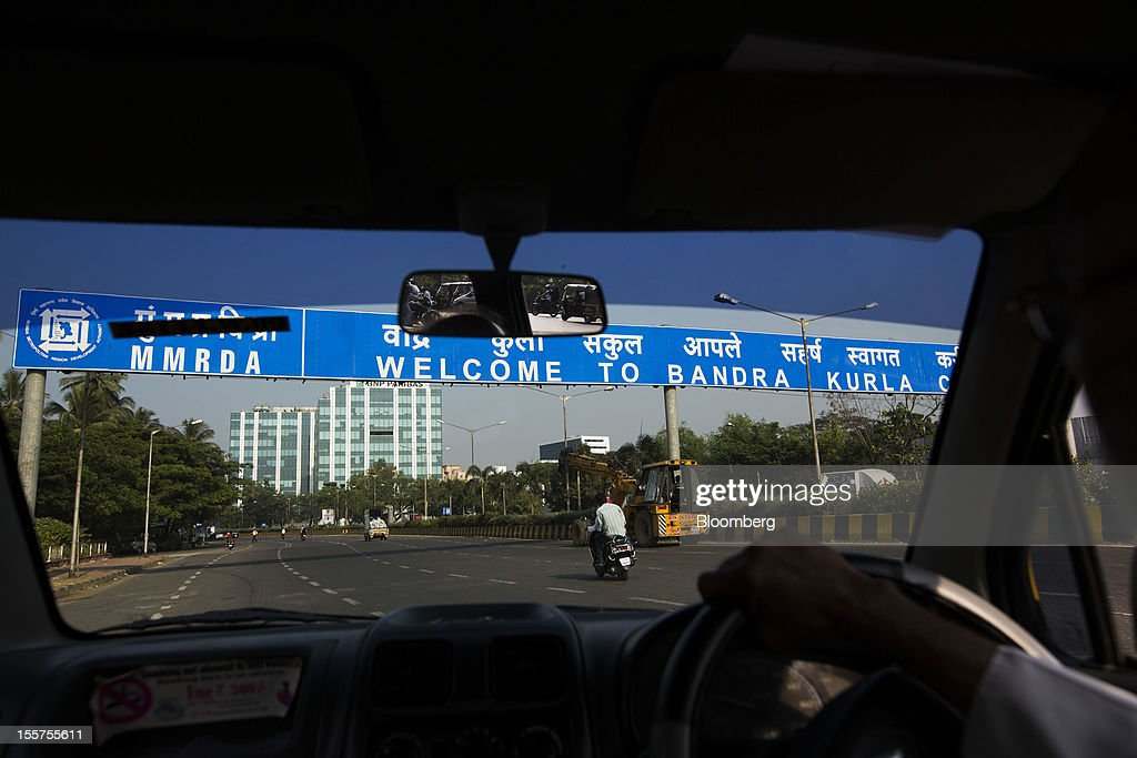 A taxi drives toward the Bandra Kurla Complex in Mumbai, India, on Tuesday, Nov. 6, 2012. Reserve Bank of India Governor Duvvuri Subbarao lowered the RBI's forecast for India's gross domestic product growth in the year through March to 5.8 percent, the slowest in almost a decade, from 6.5 percent. Photographer: Brent Lewin/Bloomberg via Getty Images