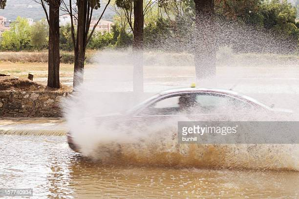taxi driving through flood water