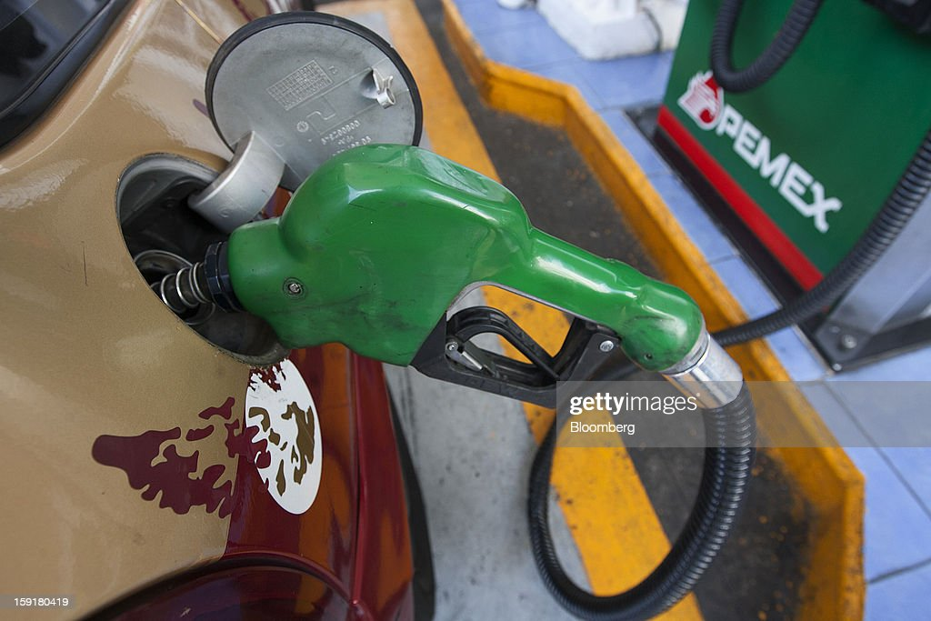 A taxi gets its tank filled with gasoline at a Pemex station in Mexico City, Mexico, on Tuesday, Jan. 8, 2013. Mexico's government is speeding up the removal of subsidies on gasoline and increasing local unleaded gasoline prices by 11 centavos in January, according to the Finance Ministry. Photographer: Susana Gonzalez/Bloomberg via Getty Images