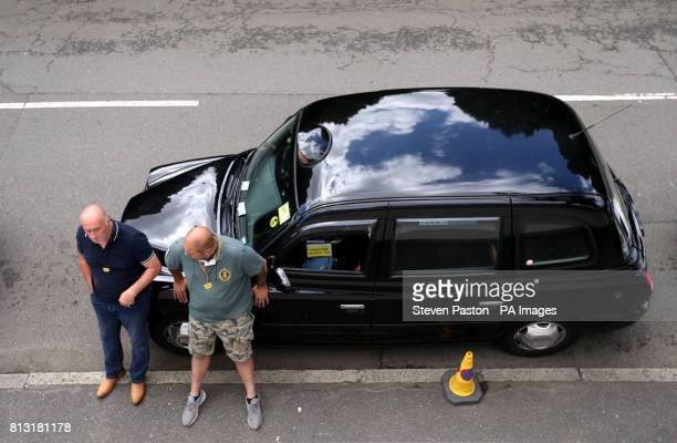 A taxi in a rank outside the grounds wait for spectators on day nine of the Wimbledon Championships at The All England Lawn Tennis and Croquet Club...