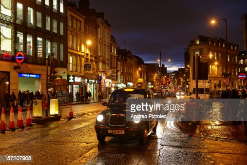 Taxi in London by night : Stock Photo