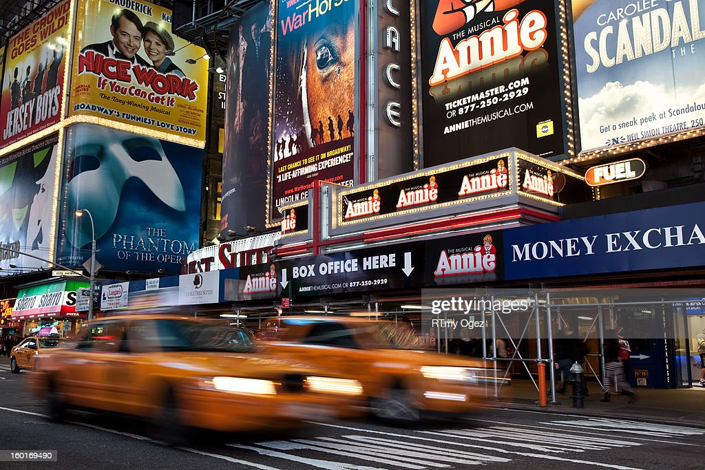 CONTENT] Taxi in Time Square by night