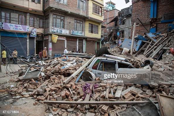 A taxi is buried under debris from a collapsed building in Thamel following an earthquake on April 25 2015 in Kathmandu Nepal A major 78 earthquake...