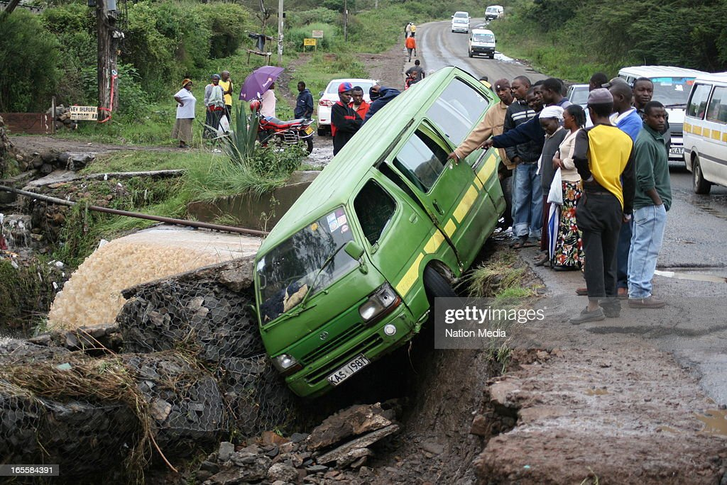 A taxi lands in a ditch after heavy floods on April 1, 2013 in Nairobi, Kenya. Thousands of people have been displaced by the heavy rains with houses destroyed and livestock lost. At least 10 people have reportedly been killed by the floods.