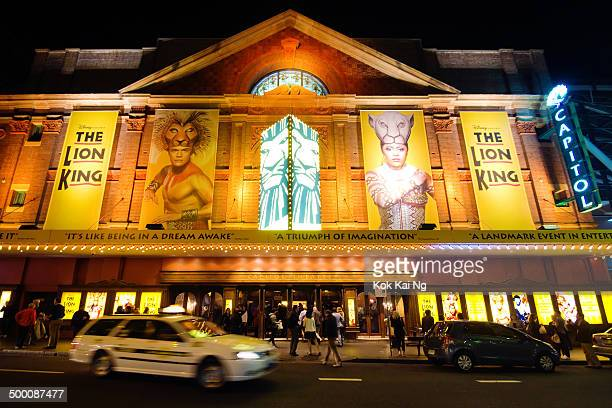CONTENT] A taxi leaves after dropping off a passenger at historic Capitol Theatre on Campbell St at night Other patrons are gathered around the...