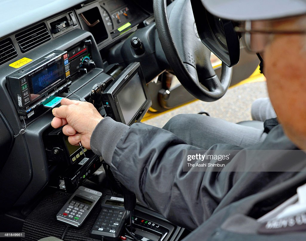 A taxi meter worker inserts the data card which can add the new 8 percent consumption tax into the current meter on March 31, 2014 in Okayama, Japan. Companies in Japan devised new business strategies while others displayed confusion and fear on April 1, when the consumption tax rate jumped from 5 percent to 8 percent.