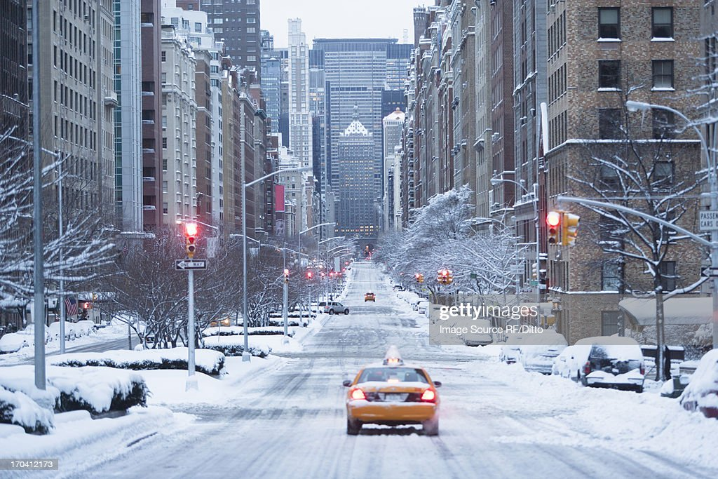 Taxi on snowy city street : Stock Photo