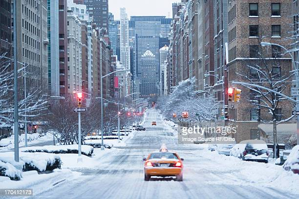 Taxi on snowy city street