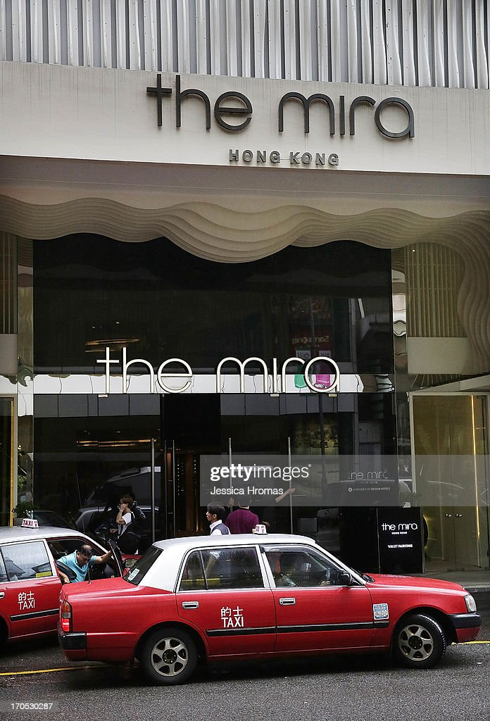 A taxi pulls up in front of the Mira Hotel on June 14 2013 in Kowloon Hong Kong Former CIA employee Edward Snowden accused of leaking details of...