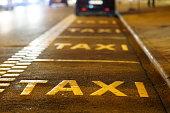 Taxi sign on asphalt