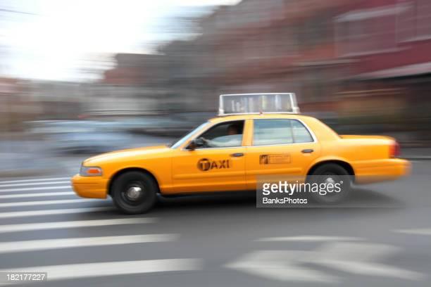 Taxi Speeding Through Intersection