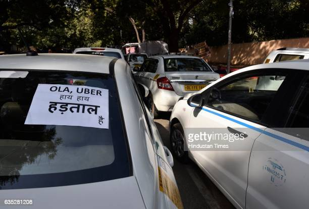 Taxi stranded as Ola Uber drivers sitting on dharna at Jantar Mantar on February 14 2017 in New Delhi India For the last five days cab aggregators...