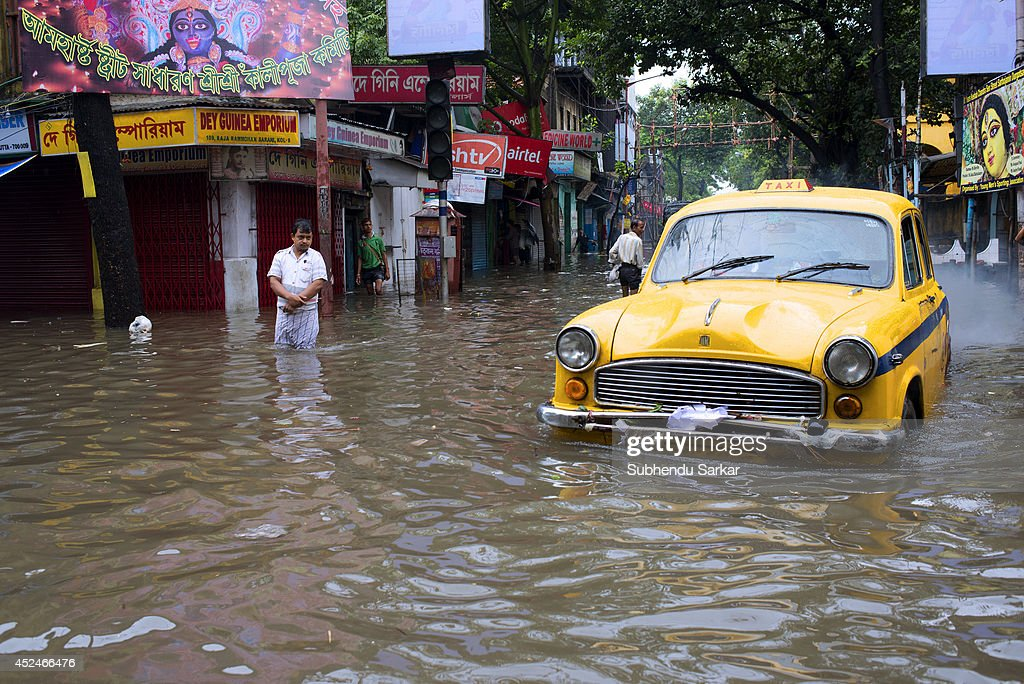 A taxi stranded in a water-logged street in Kolkata. Heavy rains resulted in water logging in many parts of Kolkata (Calcutta), India with daily life badly affected. The dirty stagnant water is due to an improper drainage system that causes many diseases and is a source of environmental pollution.