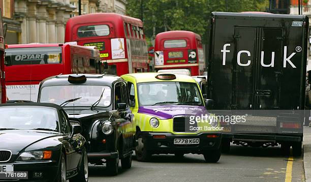 A taxi tries to make its way through traffic February 4 2003 in central London United Kingdom A congestion charge will come into effect February 17...