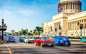 Vintage cars at rush hour in the morning in front of capitolio in La Habana. Cuba