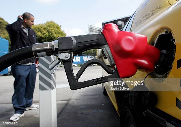 A taxicab driver pumps gas into his cab at a Chevron station May 3 2006 in San Francisco California A report released by the US Government today...