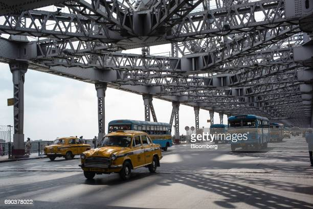 Taxis and buses travel along the Howrah Bridge in Kolkata India on Friday May 26 2017 India is scheduled to release firstquarter gross domestic...