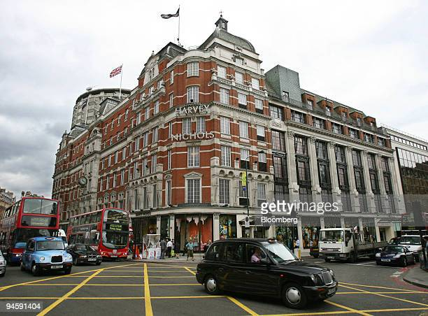 Taxis and busses pass by the Harvey Nichols department store in Knightsbridge London UK Monday June 19 2006 Suzanne Plunkett/Bloomberg News