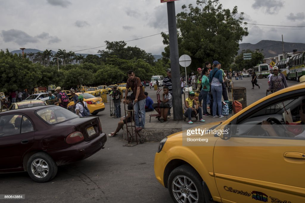 Taxis and luggage carriers wait for people crossing the San Antonio International Border in Cucuta, Colombia, on Thursday, Sept. 21, 2017. For weeks, Venezuelans have been flocking by the busload to San Antonio del Tachira, a border town of some 62,000 residents, fleeing as President Nicolas Maduro consolidates autocratic power. According to Colombia's migration authority, the number of foreigners entering Cucuta, the first major city across the bridge, more than doubled this summer. Photographer: Nicolo Filippo Rosso/Bloomberg via Getty Images