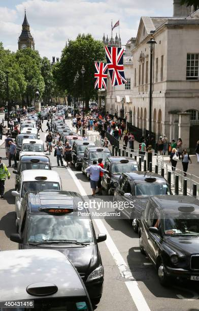 Taxis blockade Whitehall on June 11 2014 in London England London's licensed black taxi drivers are campaigning against the introduction of the...
