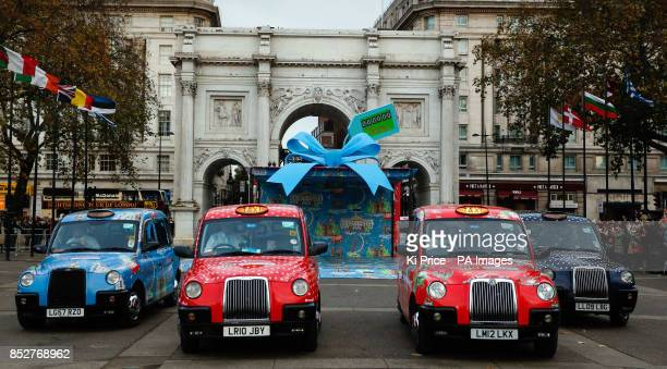 Taxis covered in Cath Kidston prints burst out of a huge present at Marble Arch The taxis offer free journeys to the Cath Kidston flagship store on...