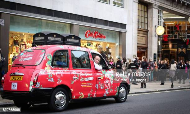 Taxis covered in Cath Kidston prints which offer free journeys to the Cath Kidston flagship store on its opening day today in Piccadilly London
