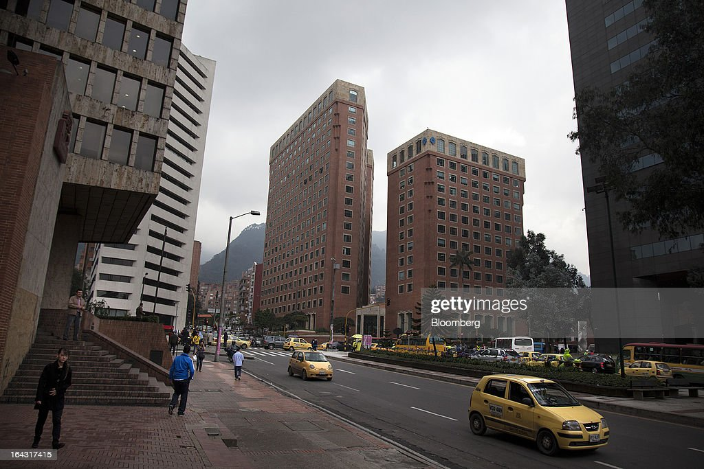 Taxis drive down the street in the financial district of Bogota, Colombia, on Friday, March 22, 2013. Central bank policy makers will lower borrowing costs by 25 basis points to 3.5 percent on March 22, according to 29 of 32 analysts and economists surveyed by Bloomberg. Photographer: Jose Cendon/Bloomberg via Getty Images