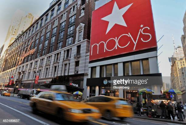 Taxi's drive past Macy's Inc flagship store in New York US on Thursday Nov 29 2013 Terry Lundgren president and chief executive officer of Macy's Inc...