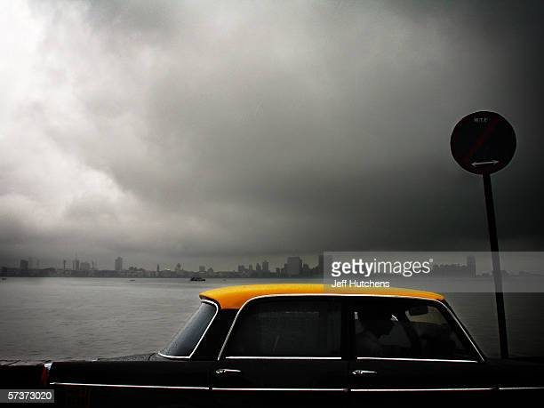 A taxis drives along the water front on September 09 2005 in Mumbai India Emerging from one of the most deadly monsoon seasons in recent history...
