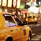 Taxis driving through times square in New York city