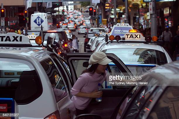 Taxis on a crowded Market Street Sydney 29 December 2006 SMH NEWS Picture by WADE LAUBE