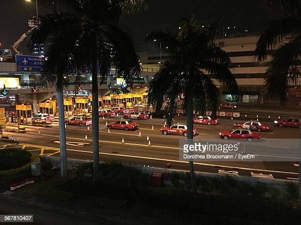 Taxis On Road At Toll Booth In City