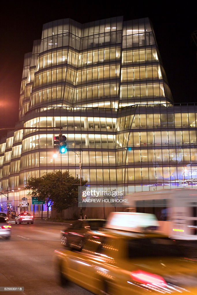 Taxis pass the IAC building at night Architect Frank Gehry's first New York City building the IAC building is corporate headquarters of Barry...