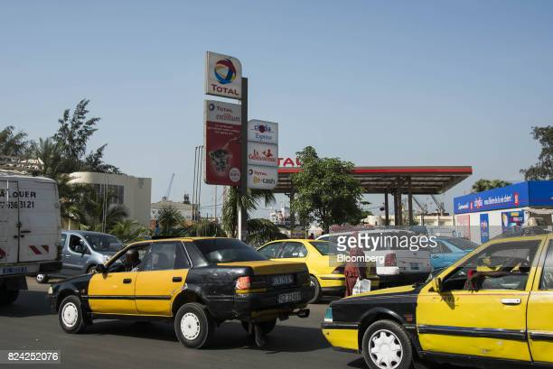 Taxis queue in front of a gas station operated by Total SA in Dakar Senegal on Friday July 28 2017 Senegalese voters will elect a new parliament on...