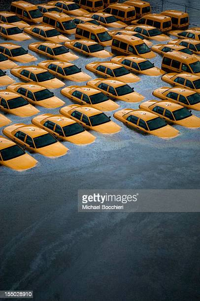 Taxis sit in a flooded lot after Hurricane Sandy October 30 2012 in Hoboken New JerseyThe storm has claimed at least 40 lives in the United States...